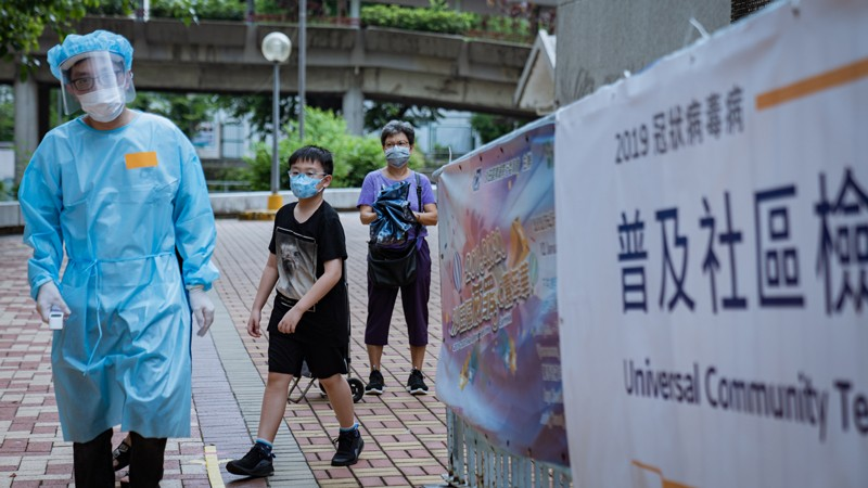 A medical staff dressed in a protective suit during the voluntary mass-testing programme for coronavirus, Hong Kong.