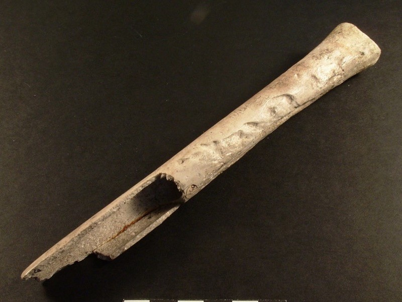 A human femur turned into a musical instrument, found in Wiltshire