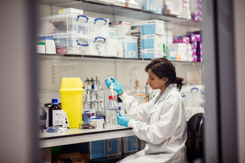 A woman working in a lab
