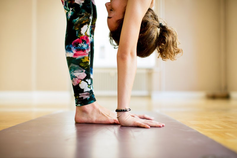 Young woman practicing Vinyasa yoga