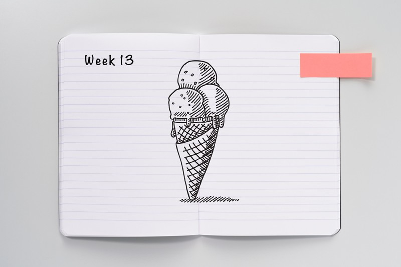 An open notebook with a sketch of an ice cream cone