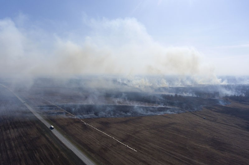 An aerial view of a grass fire in the fields in Bolotnoye District, south Siberia