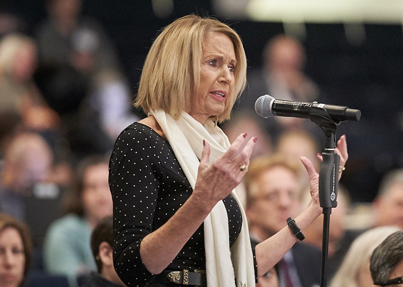 Marcia McNutt speaks into a microphone at an event in 2020