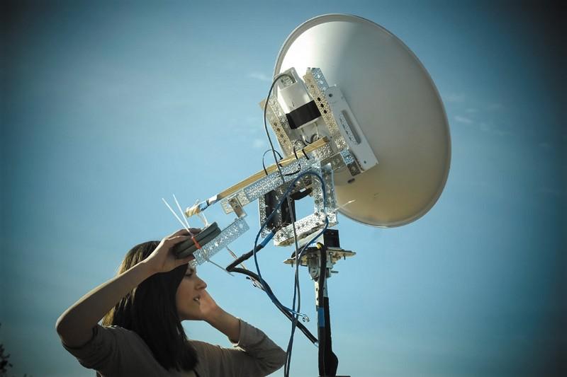 Jessica Frantz holding an atmospheric sampling receiver