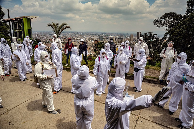 Workers of Bogota, Colombia's mayor's office wear protective suits before conducting a census