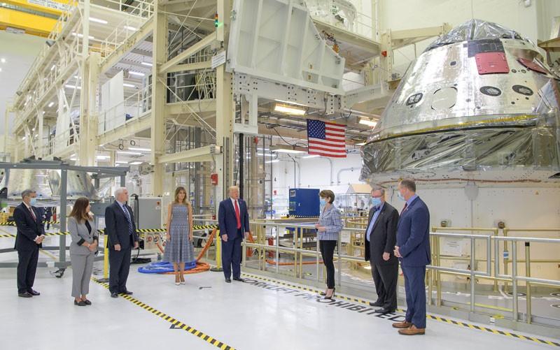 President Donald Trump views the Artemis II space capsule