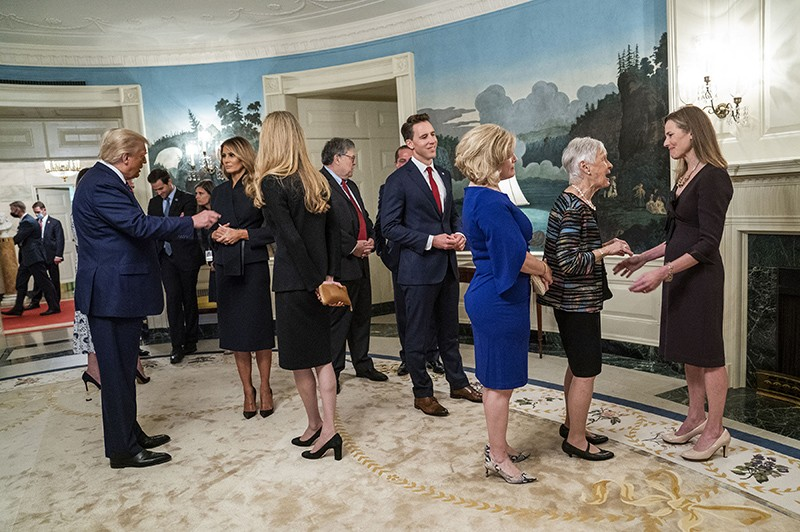 An indoor gathering at the White House with President Donald Trump in attendance
