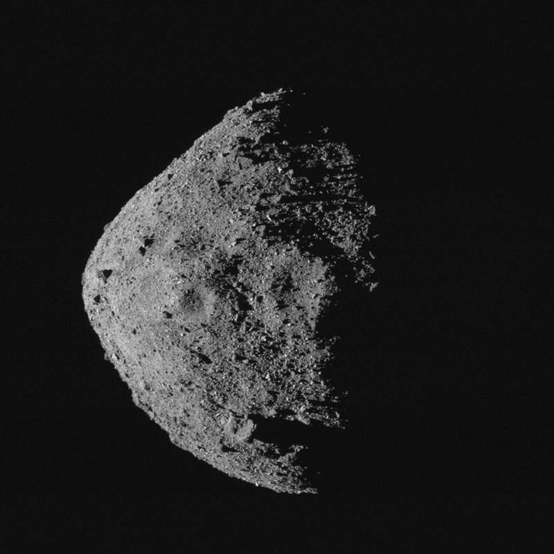 The equatorial crescent of the asteroid Bennu and its boulder-filled surface.