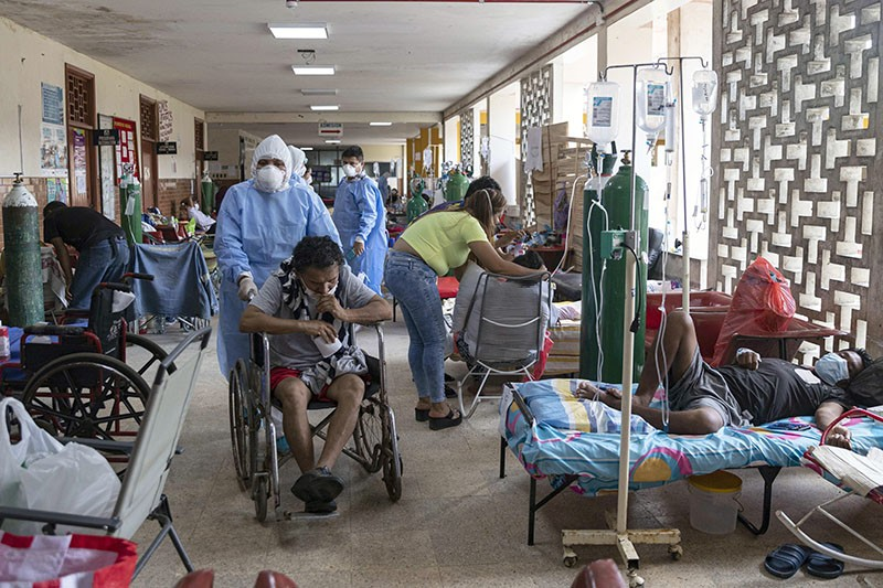 Doctors in biosecurity suits tend to patients with COVID-19 at the Regional Hospital of Iquitos, Peru