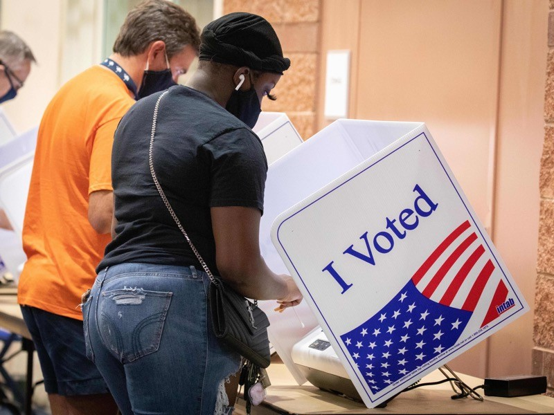 Voters cast their ballots in the voting booths at the early vote, South Carolina.