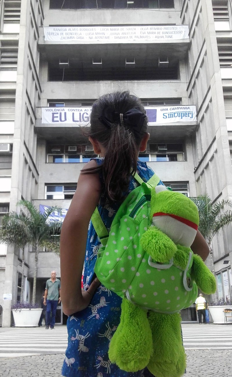 A young girl confidently looks at a building.