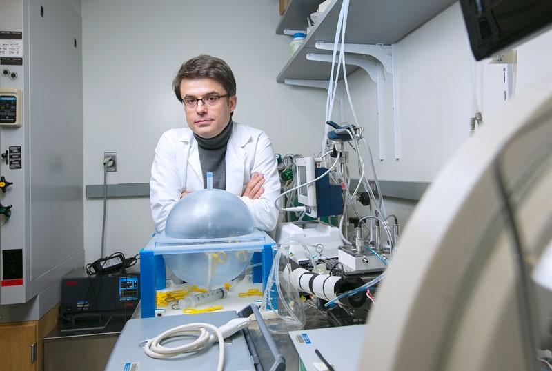 Nenad Sestan posing for a portrait in a laboratory