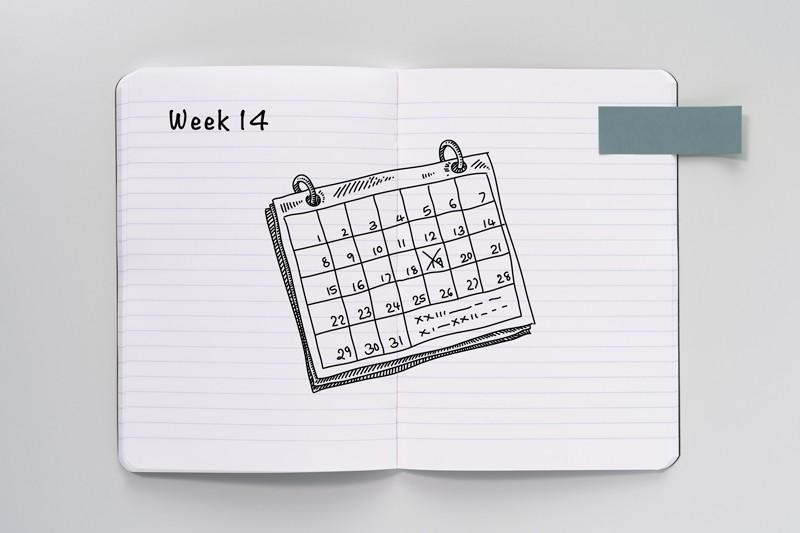 Sketch of a calendar on an open notebook