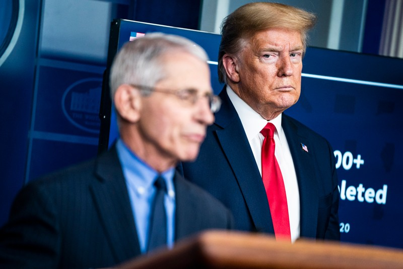 President Donald J. Trump listens to Dr. Anthony Fauci
