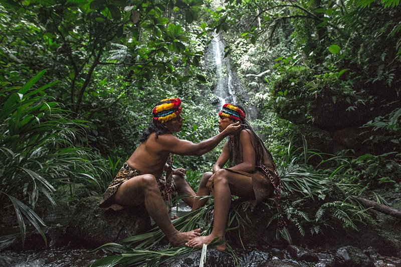 An Amazonian Shaman and his apprentice in the forest.
