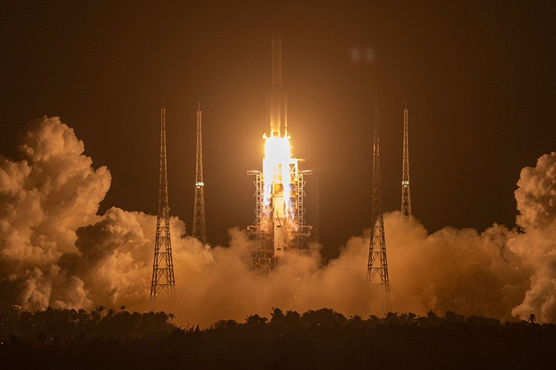 A Long March-5 rocket carrying the Chang'e 5 lunar mission lifts off at the Wenchang Space Launch Center in China