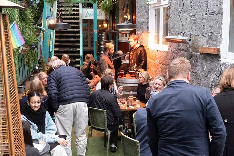 People gather at a bar in Reykjavik, Iceland, as bars reopened after a two-month closure