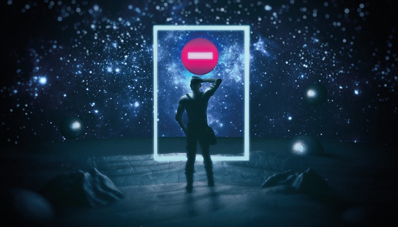 "A lone figure stands in front of a space portal that is showing a ""no entry"" sign"