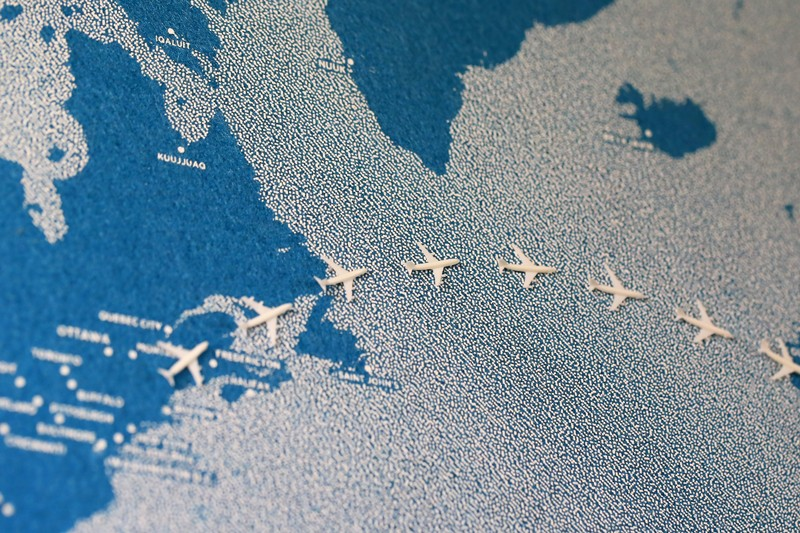 Painted map with flying planes