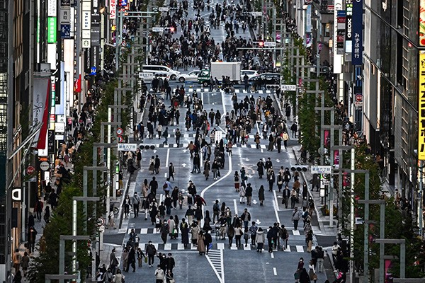 People walk on a street in Tokyo on 22 November 2020.