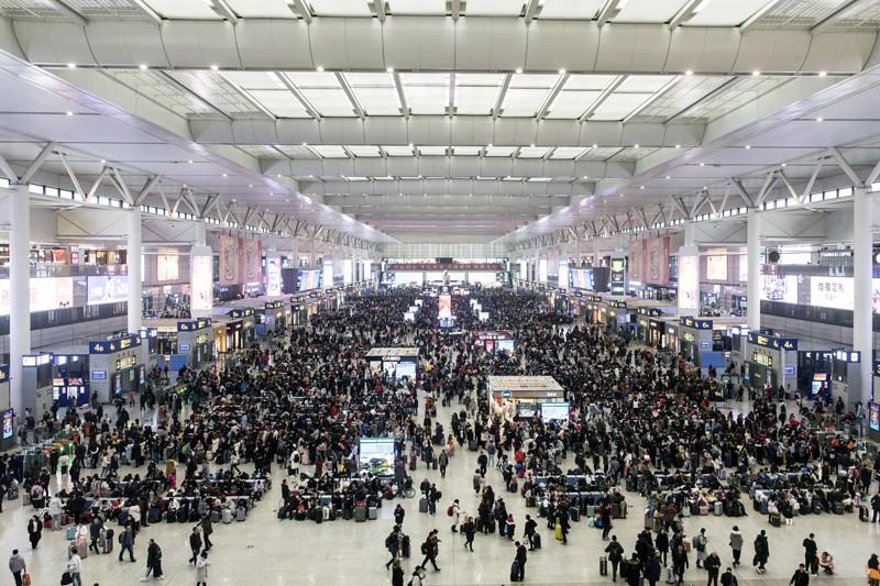 Travelers wait in the main hall of the Hongqiao Railway Station in Shanghai, China