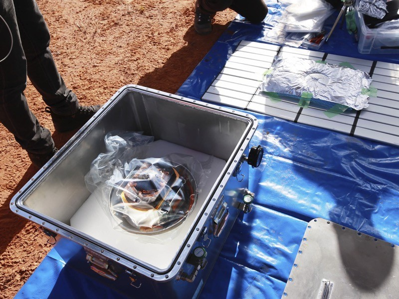 Members of JAXA retrieve a capsule dropped by Hayabusa2 in Woomera, southern Australia.
