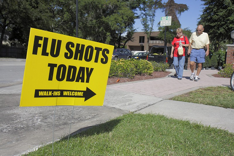 Flu shots sign on the street