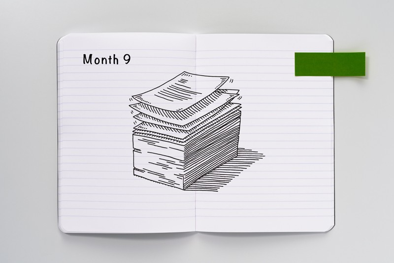 Sketch of a stack of papers on an open notebook