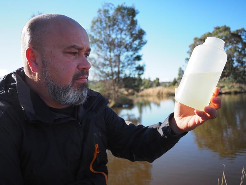 Bradley Moggridge sampling water