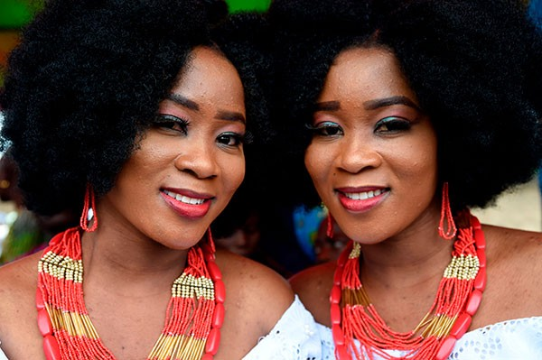 Identical twin sisters Kehinde Olofin (L) and Taye Olofin (R) attends Igbo-Ora World Twins festival