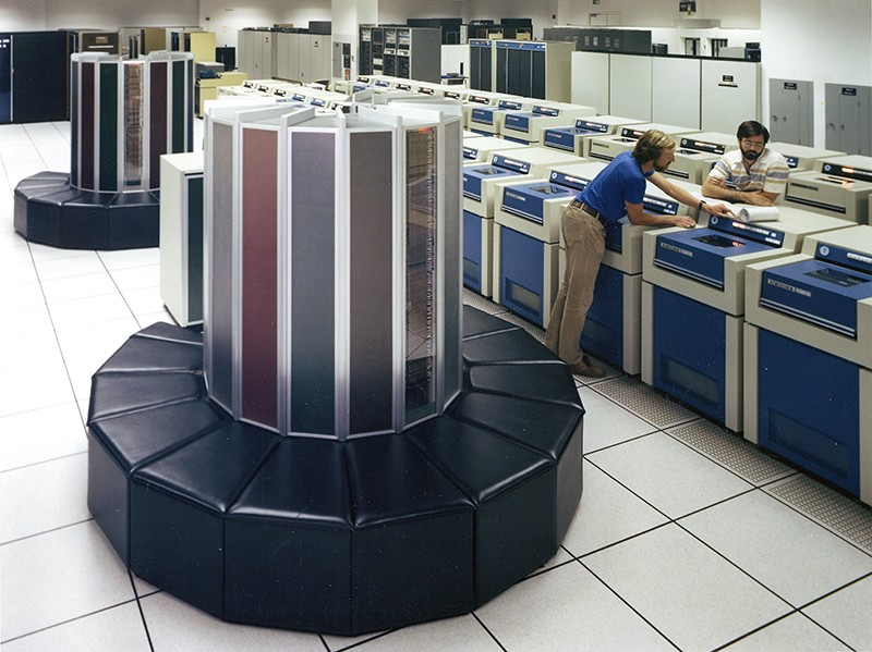 A Cray-1 Supercomputer with workers at Lawrence Livermore National Laboratory in 1983