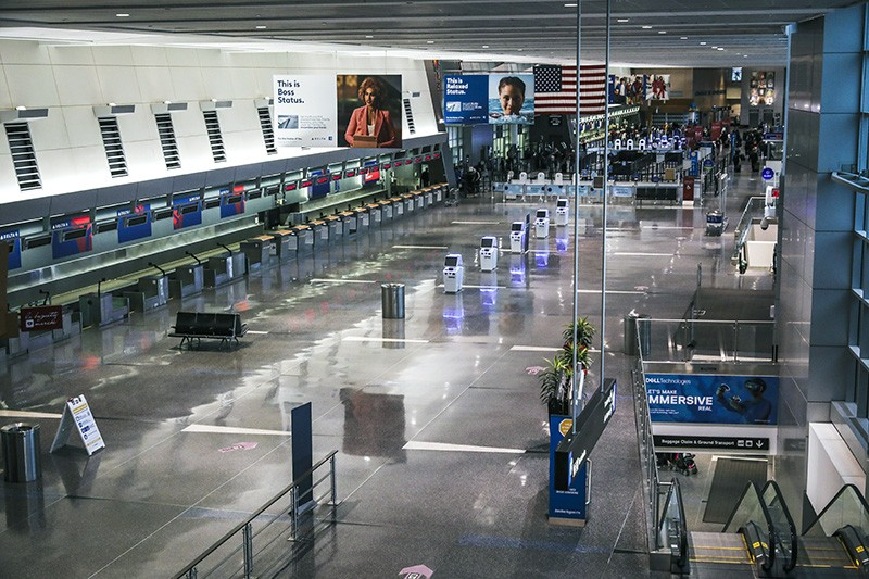 An airport departures hall, with no people.