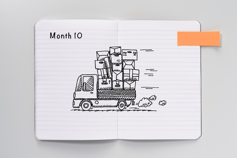 Open notebook with a sketch of a delivery van