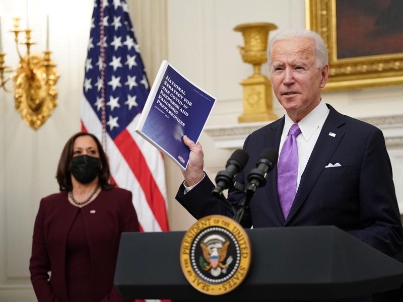 US President Joe Biden speaks about the Covid-19 response as US Vice President Kamala Harris looks.