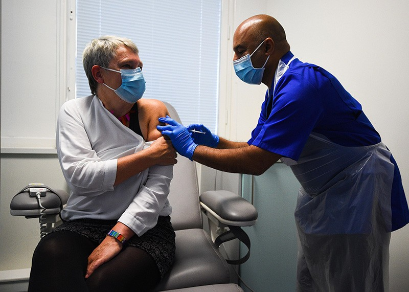A Novavax vaccine trial with a patient and health care provider in London
