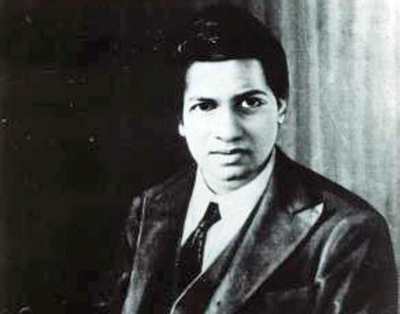 Black and white photo of Srinivasa Ramanujan.