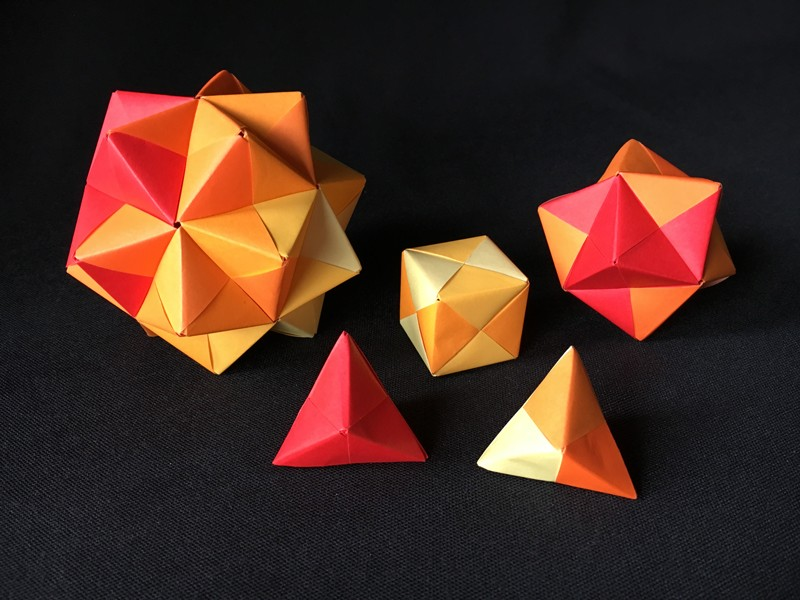 A collection of sonobe modular origami polyhedra made by Jeanette McLeod.