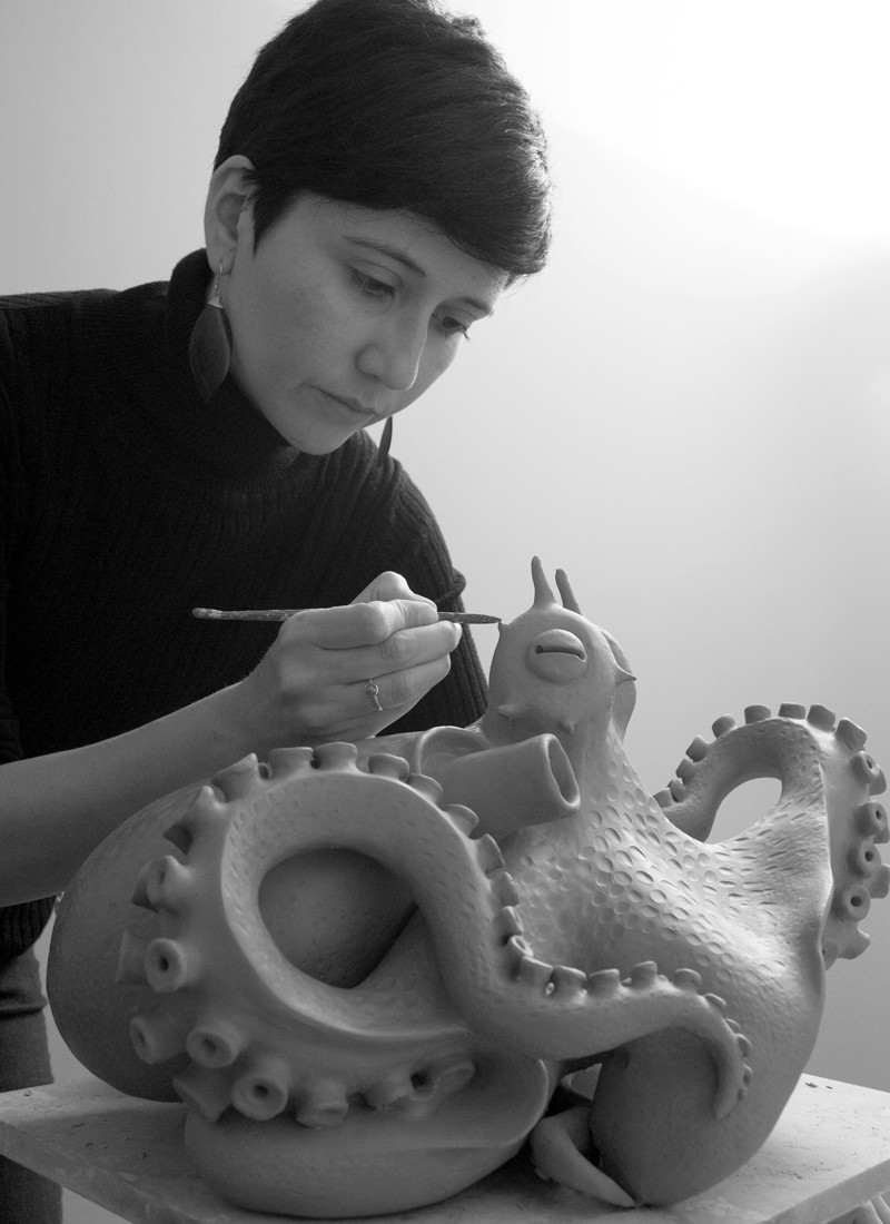 """Fernanda Oyarzun working on a sculpture of a coconut-octopus for the series """"Marine Consciousness""""."""
