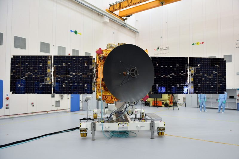 The Hobe Probe with extended solar panels and central satellite dish in a clean room