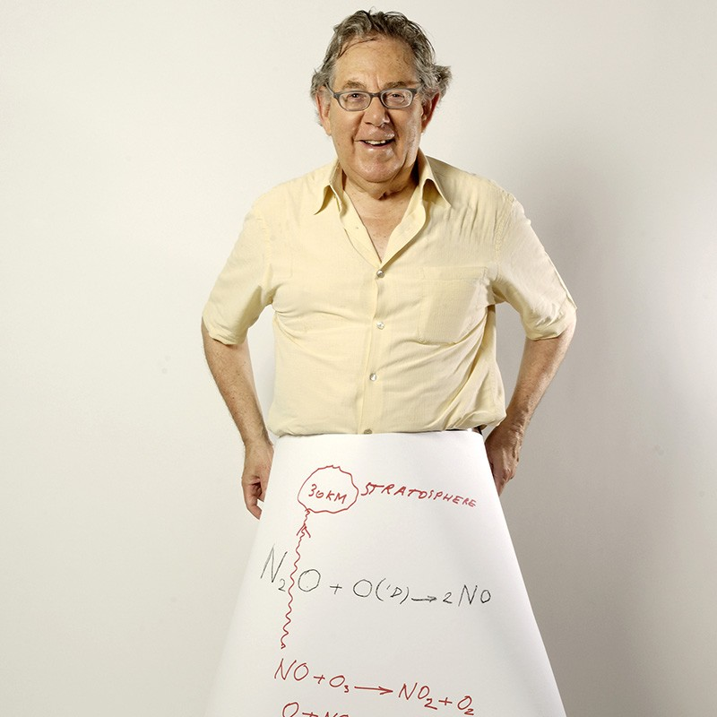 Paul J. Crutzen holding a sheet showing the reaction of nitrogen oxides with ozone