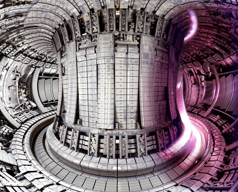 A section of pink plasma superimposed on JET vessel equipped with the ITER-Like wall
