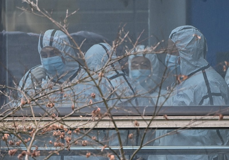Members of the WHO team in protective gear.
