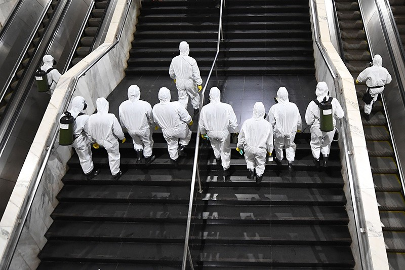 Brazilian soldiers enter the Subway Central Station for its disinfection of coronavirus