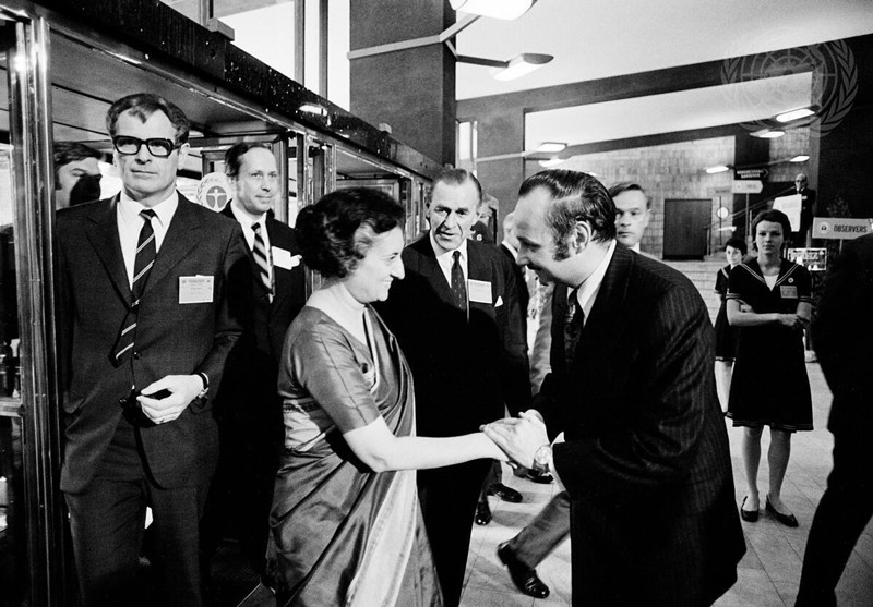 Indira Gandhi being greeted by Maurice Strong