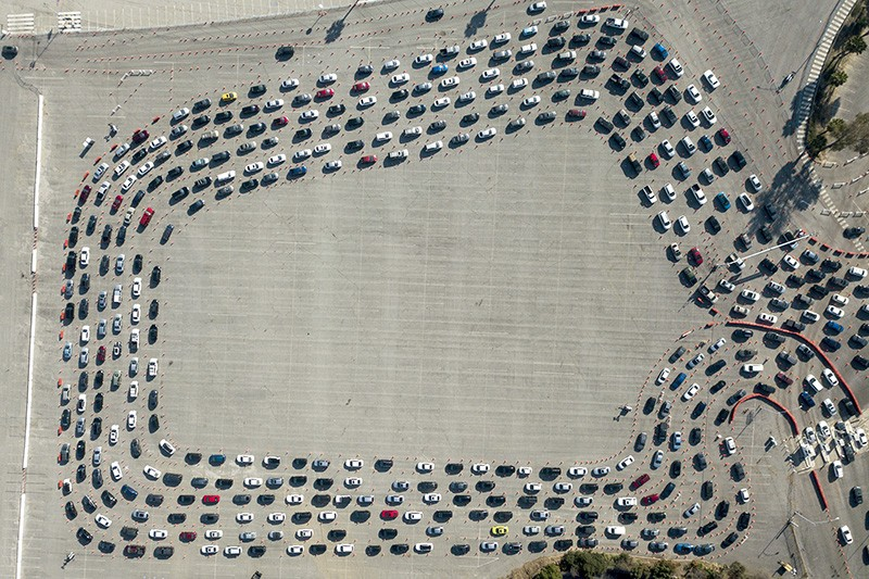 Motorists wait in long lines to take a coronavirus test in Los Angeles