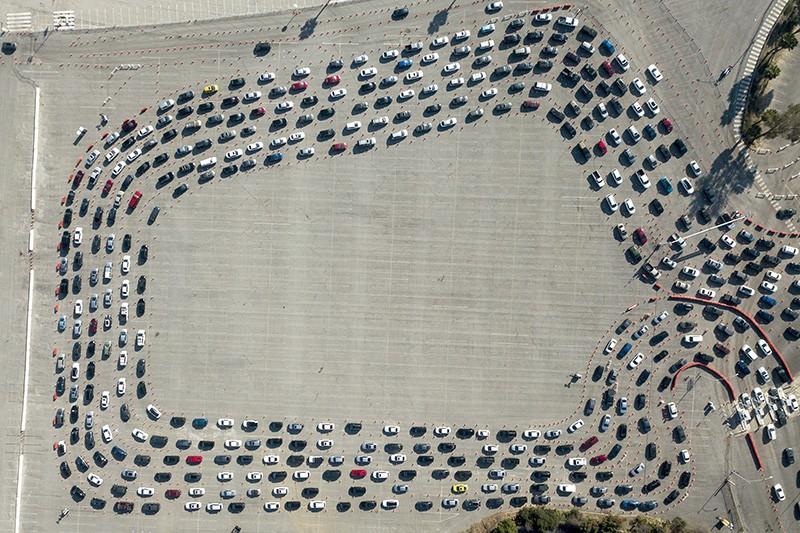 Motorists wait in long lines to take a coronavirus test in Los Angeles