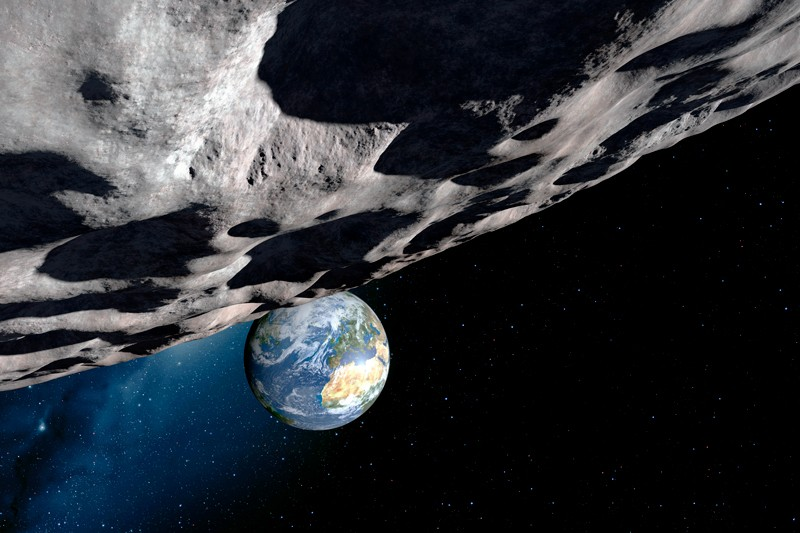 Computer artwork of an asteroid approaching Earth