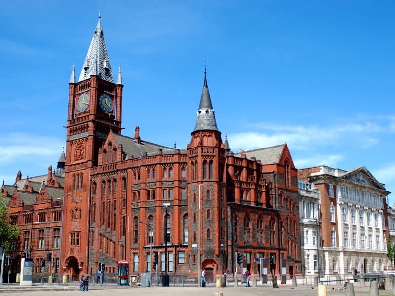 A large brick building with a clocktower