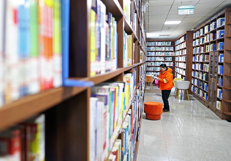 A woman reads at the library of the University of Science and Technology Liaoning in Anshan, China