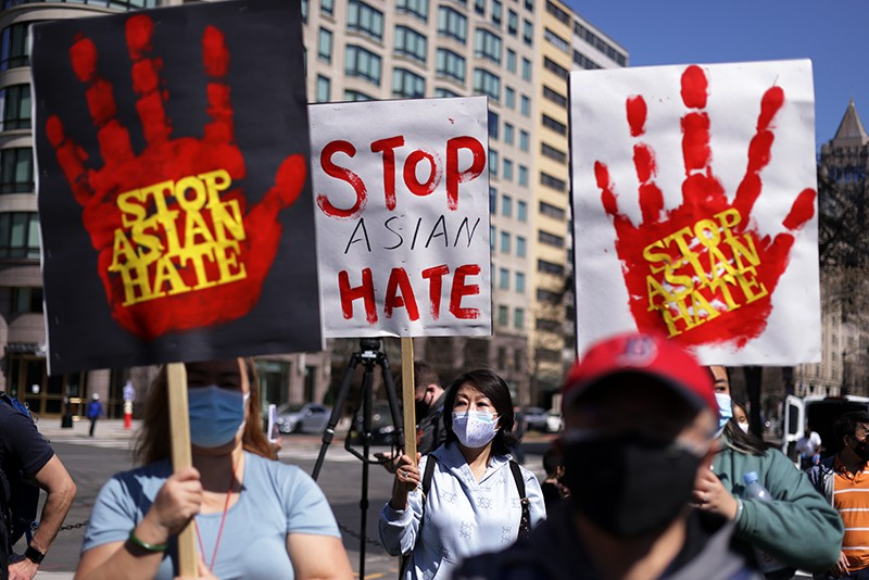 Activists in Washington, DC, participate in a rally to protect Asians from violence